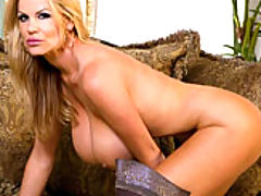 Hot Busty Movies, Kelly teases you in a teal dress then rubs on her pussy while wearing super sexy thigh high boots.