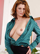 Busty Hairy, Horny Anilos woman peels off her business attire and exposes her big tits and milf pussy
