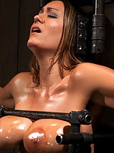 nice boobs, Trina Michaels takes the fuck machine hard and fast. She is gagged, blindfolded, whipped, caned and fingered into orgasm after orgasm.