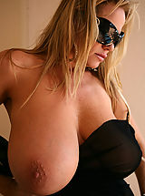 Kelly was lounging outside in a see thru black wrap that gets to hot to wear.