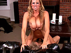 Kelly can�t sleep so she relaxes on the couch; Ryan wakes up and fucks her hard on the coffee table.