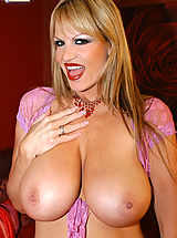 Huge Tits, Kelly is wearing red lingerie and masturbates with pink dildo.