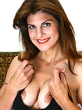 Hard Nipples, Anilos cougar Monique spreads her legs wide and plunges her experienced finger deep in her pussy