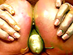 Busty Vintage, Kelly's paint gets all over her boobs so she slides her male model's cock between them.