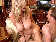 Kelly strips off her tight white tank top and pulls down her jeans to take a huge cock at the dinner table.