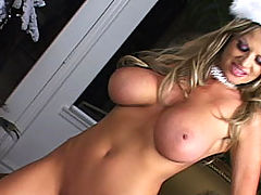 Asian Busty Movies, Kelly gets fucked and bounces her tits under the X-Mas tree.