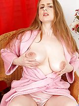 Sensual housewife Midori spreads her bright pink milf pussy
