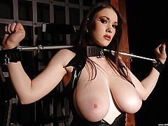 Busty Women Movies, Busty babe Anna Song tied up, in and out of tight latex