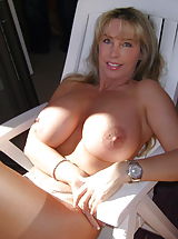 Housewives Pics: Big Breasted Slut Wifey enjoys the sunshine