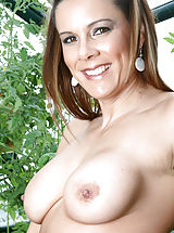 Bouncing Boobs, Brunette Anilos Victoria loves to expose her experienced shaved pussy while she hangs out in her garden