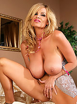 Nipples Pics: Kelly plays with her pussy in the bedroom in a pink bra.